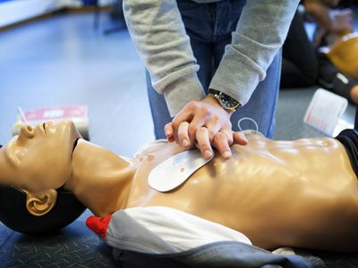 General First Aid course, Paris, France. Learning CPR coupled with a defibrillator.