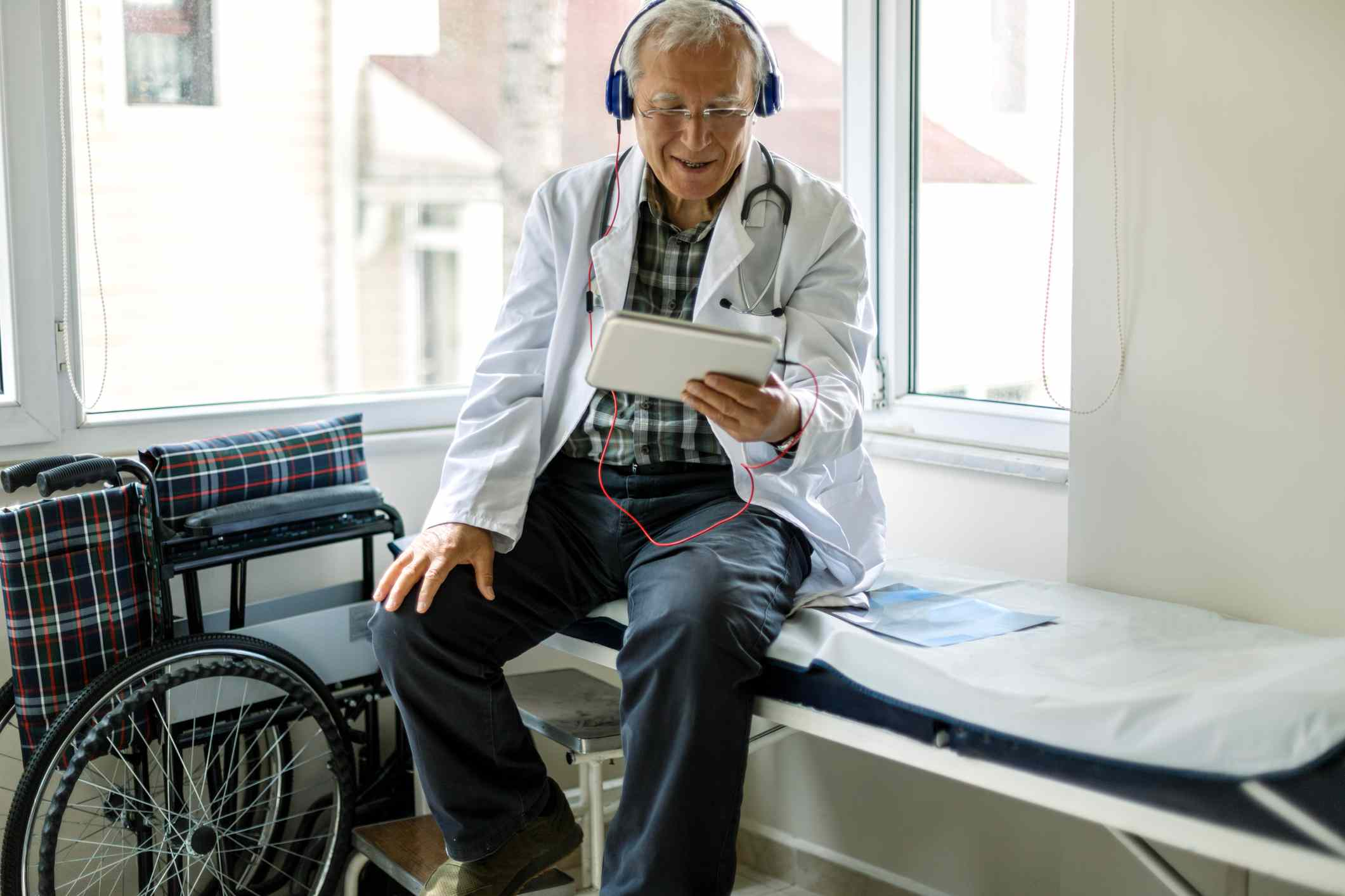 An orthopedist conducts a telehealth visit with a client