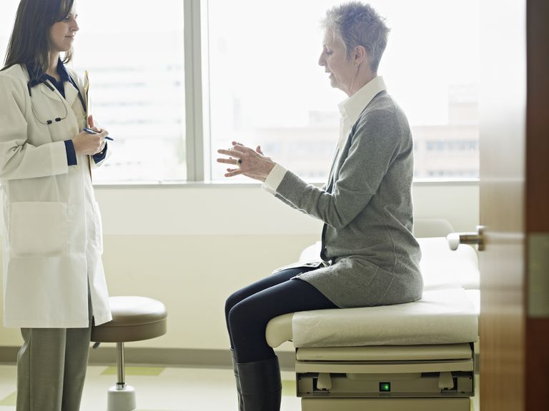 Doctor treating a female patient.