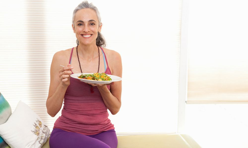 Menopausal woman eating salad