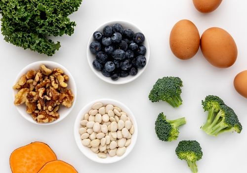 Kale, sweet potatoes, walnuts, beans, blueberries, broccoli, and eggs