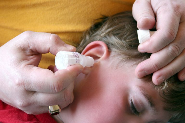Administering ear drops.