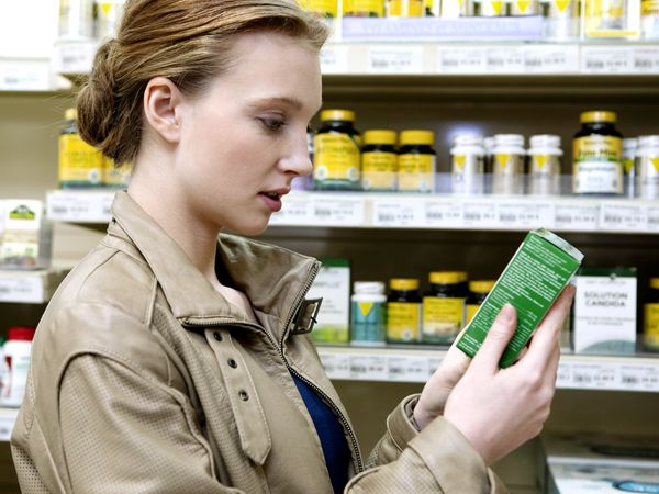 Woman looking at medication in a store