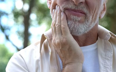 Older man with mouth pain