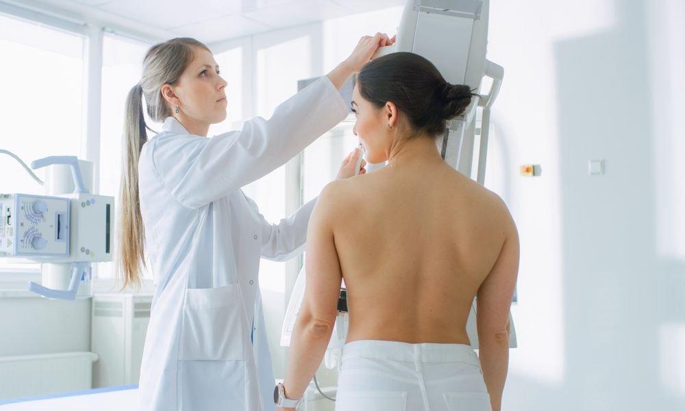In the Hospital, Female Patients Undergoes Mammogram Screening Procedure Done by Mammography Technologist. Modern Technologically Advanced Clinic with Professional Doctors. Breast Cancer Prevention Screening.