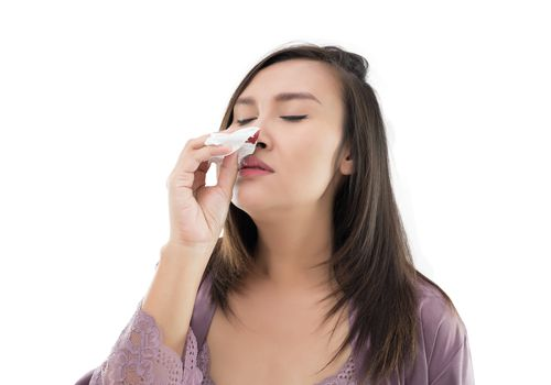 woman with a nosebleed tilting head back