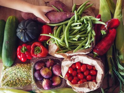 Close-up of hand reaching for fresh vegetables