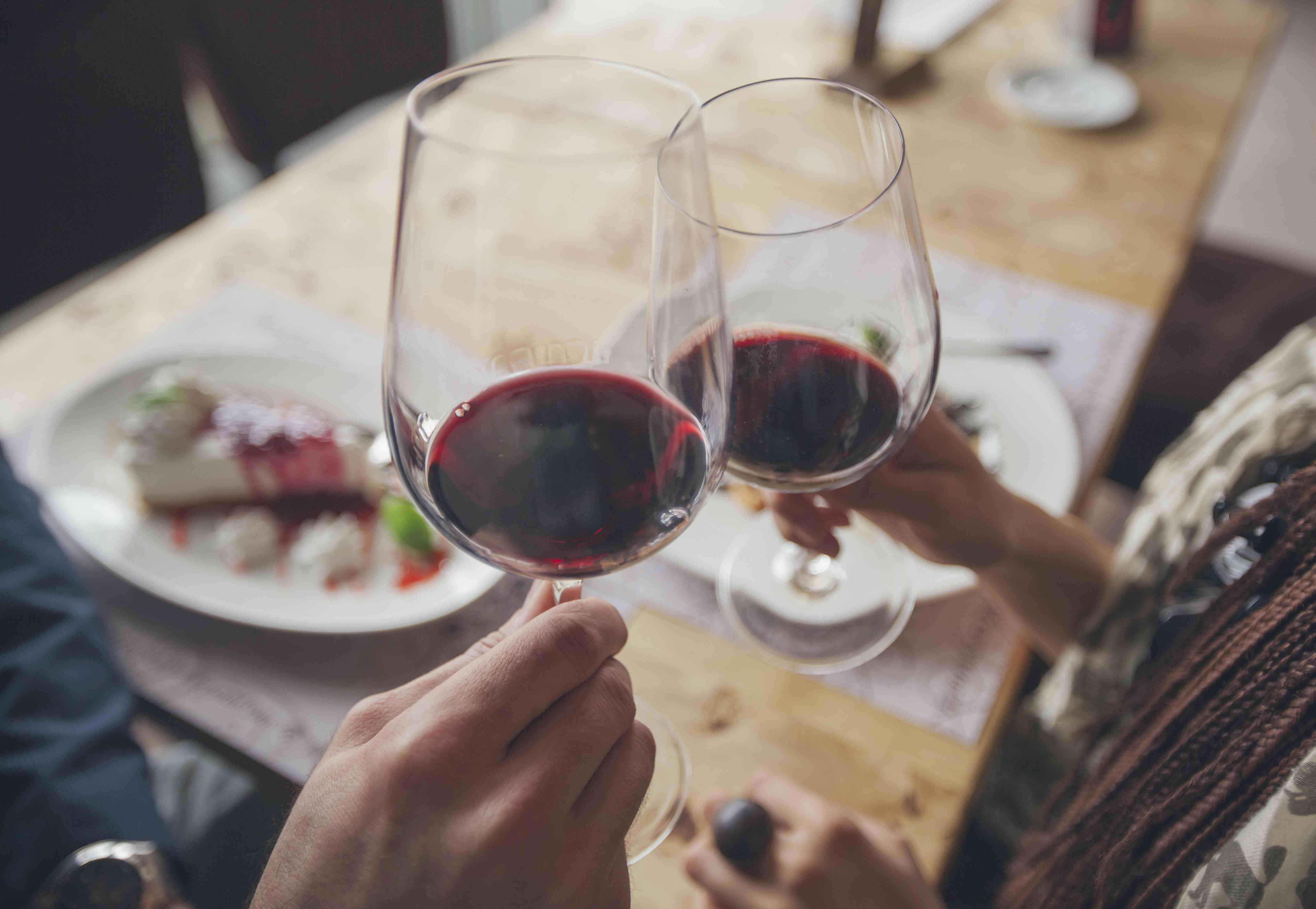 A couple toasting with wine in cafe