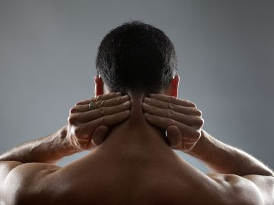Man rubbing his neck