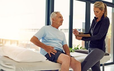 Patient being diagnosed by his physical therapist
