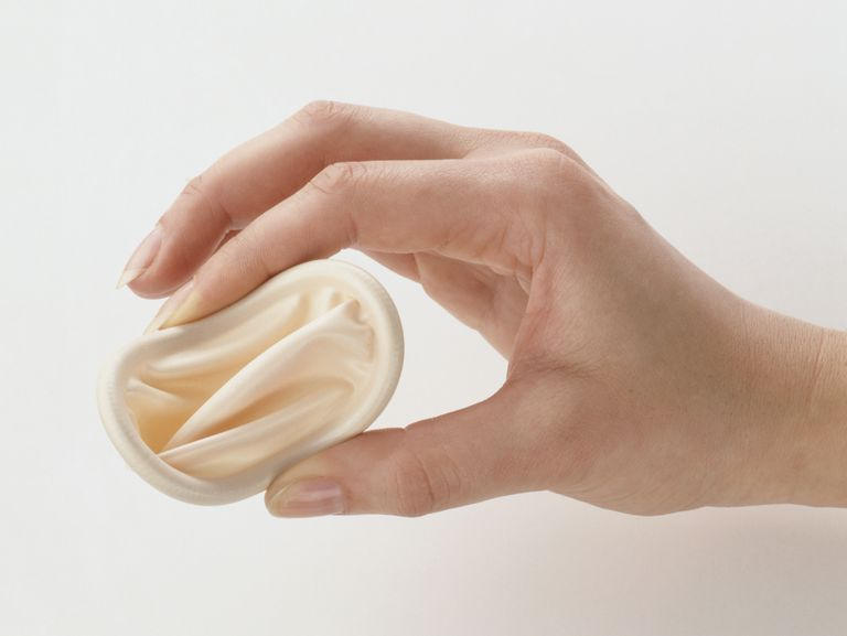 Woman's hand holding diaphragm, close-up