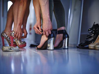 Women putting on high heels