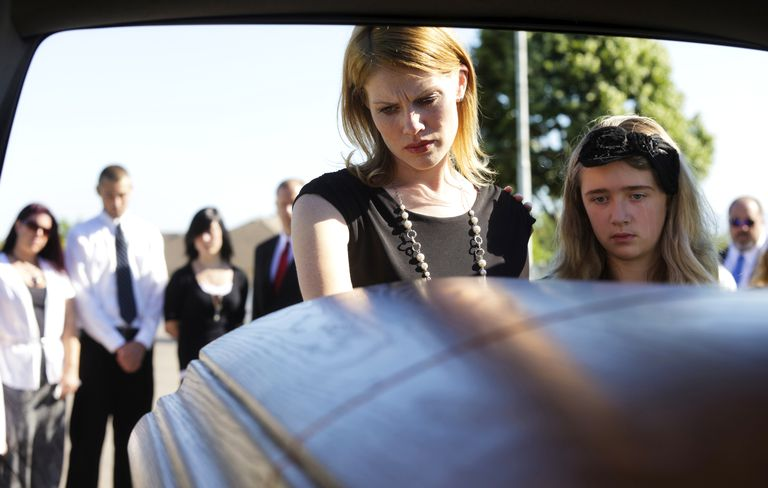 Widow and daughter at hearse
