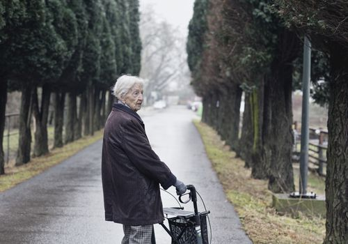 Elderly woman walking outside