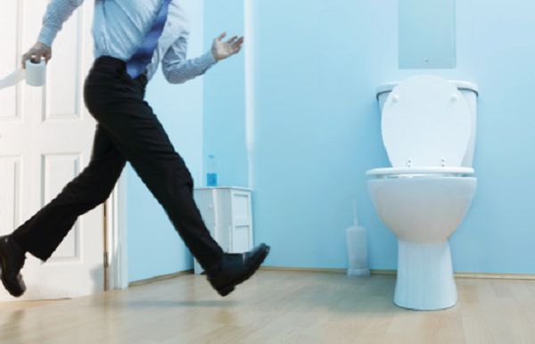 male executive running to the toilet