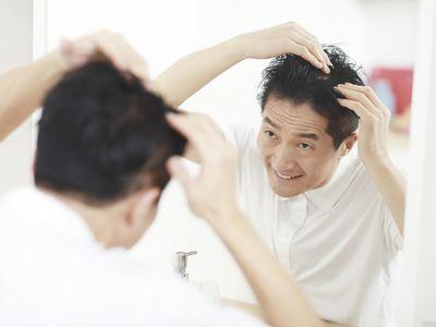 A man assessing his hair loss