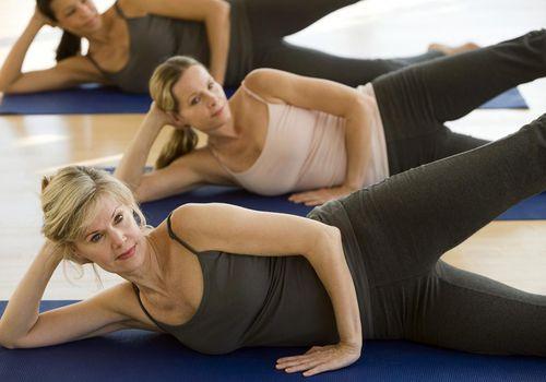 Multi-ethnic women practicing yoga.