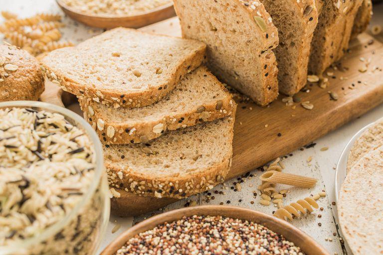 Sliced brown bread on cutting board