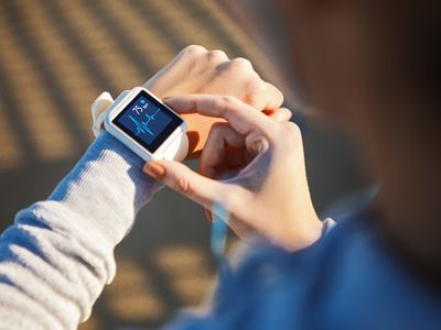 Checking Her Heart Rate on a smart watch