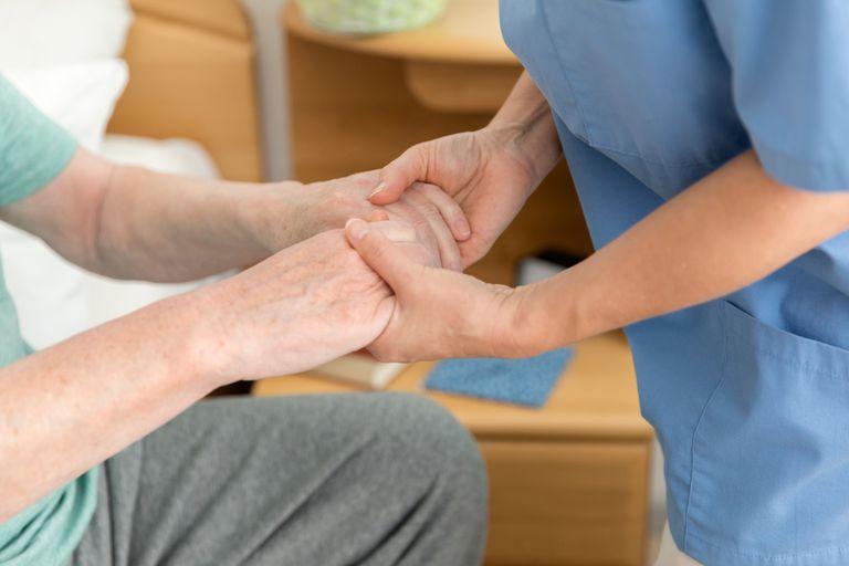 Caregiver helping senior man