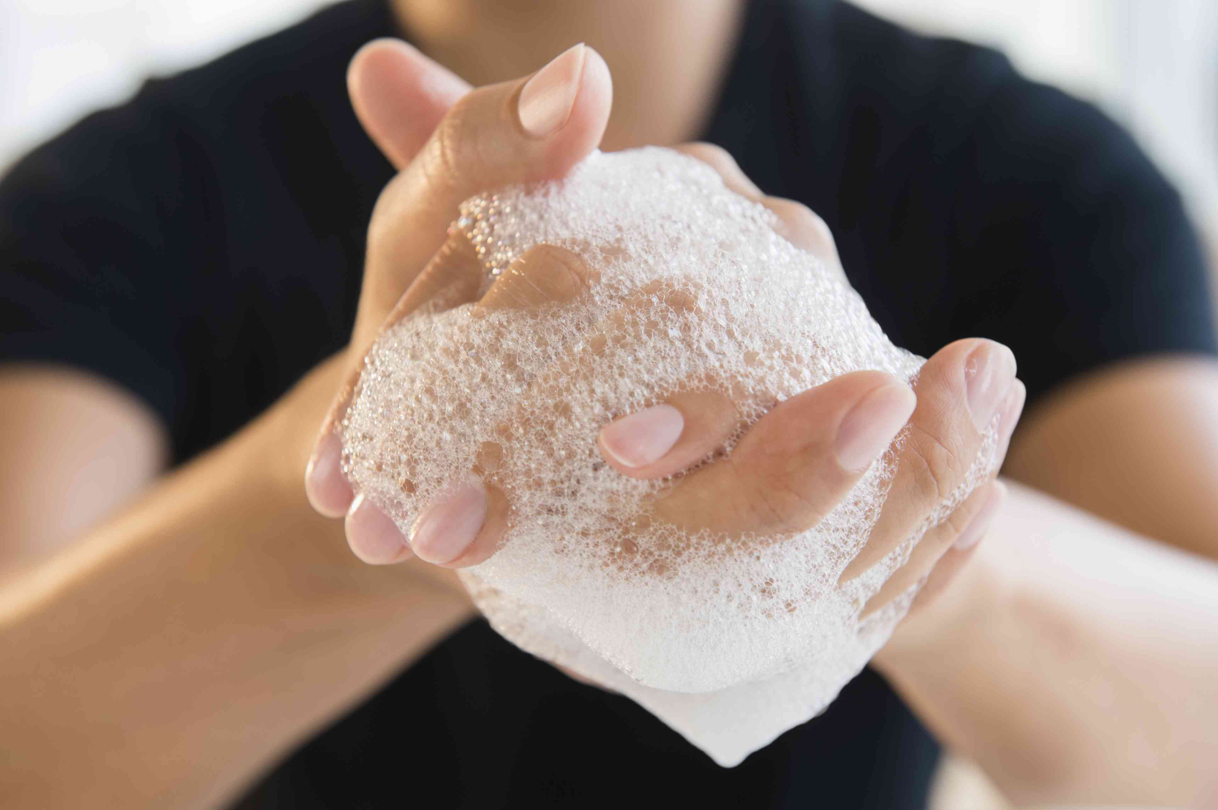 Man washing hands with antibacterial soap