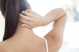 Woman scratching neck