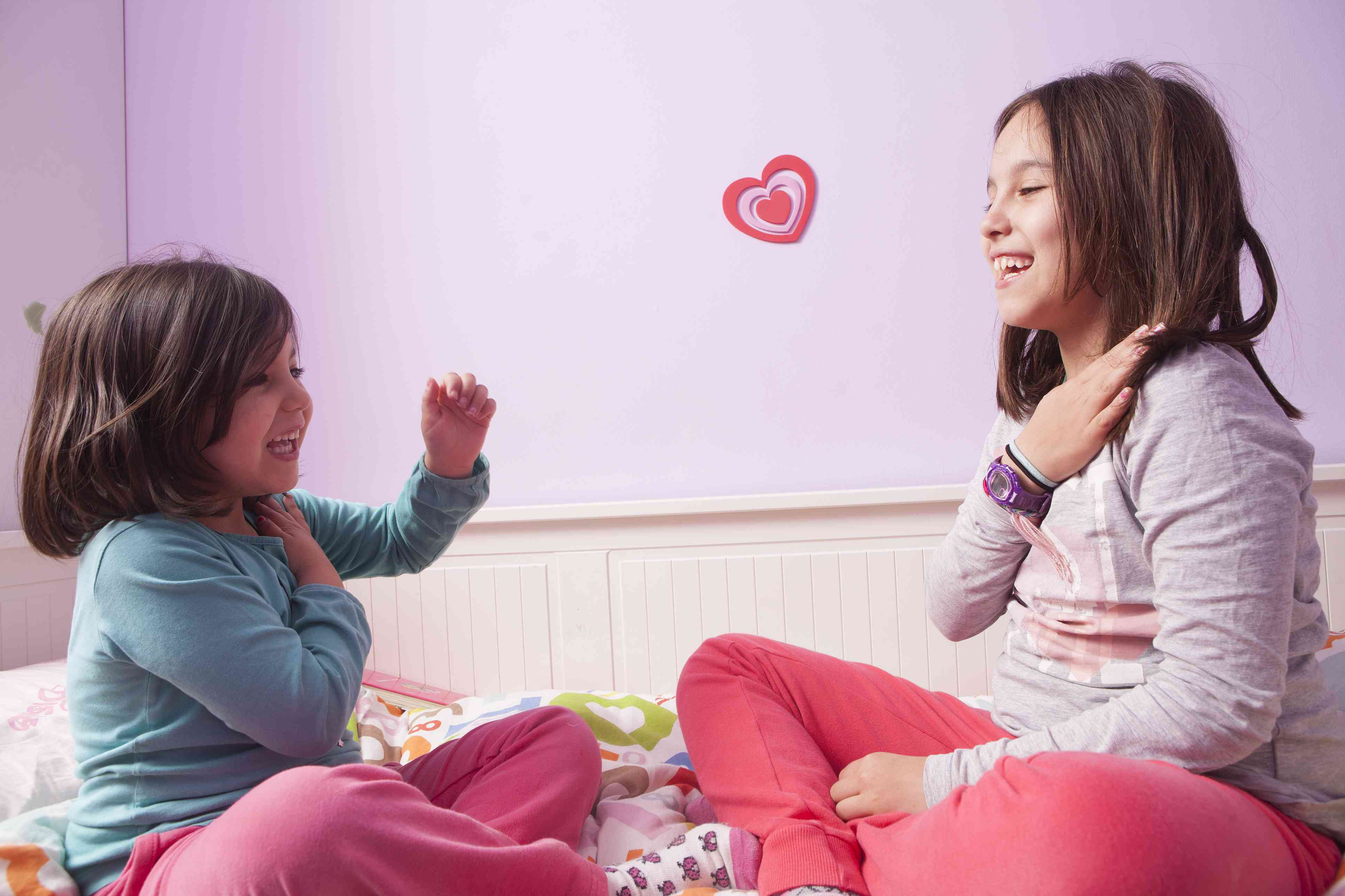 Two young children playing together in a brightly painted room