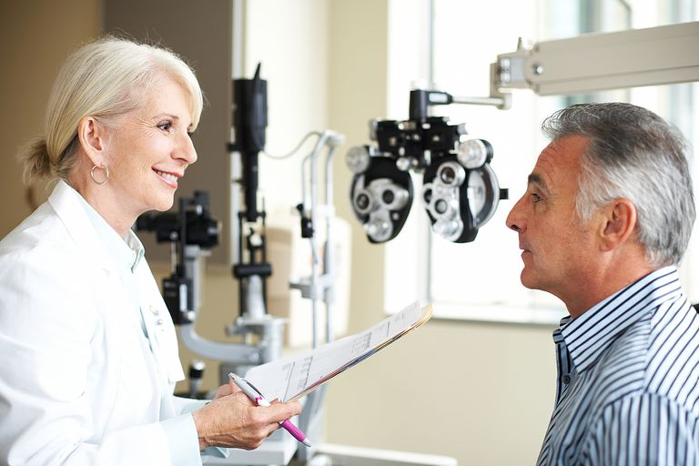 A female opthamologist listens to her patient.