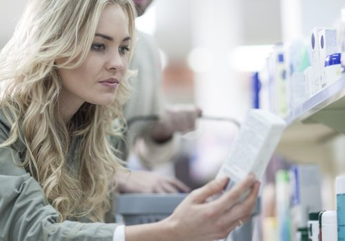 Woman shopping at drugstore