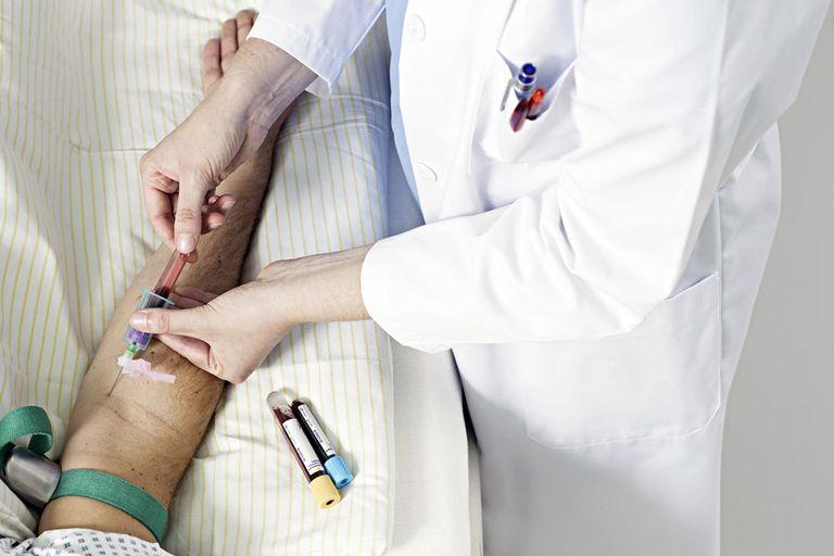 female doctor taking blood sample