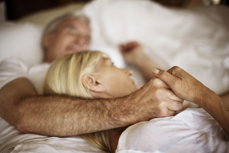 senior man and woman in bed