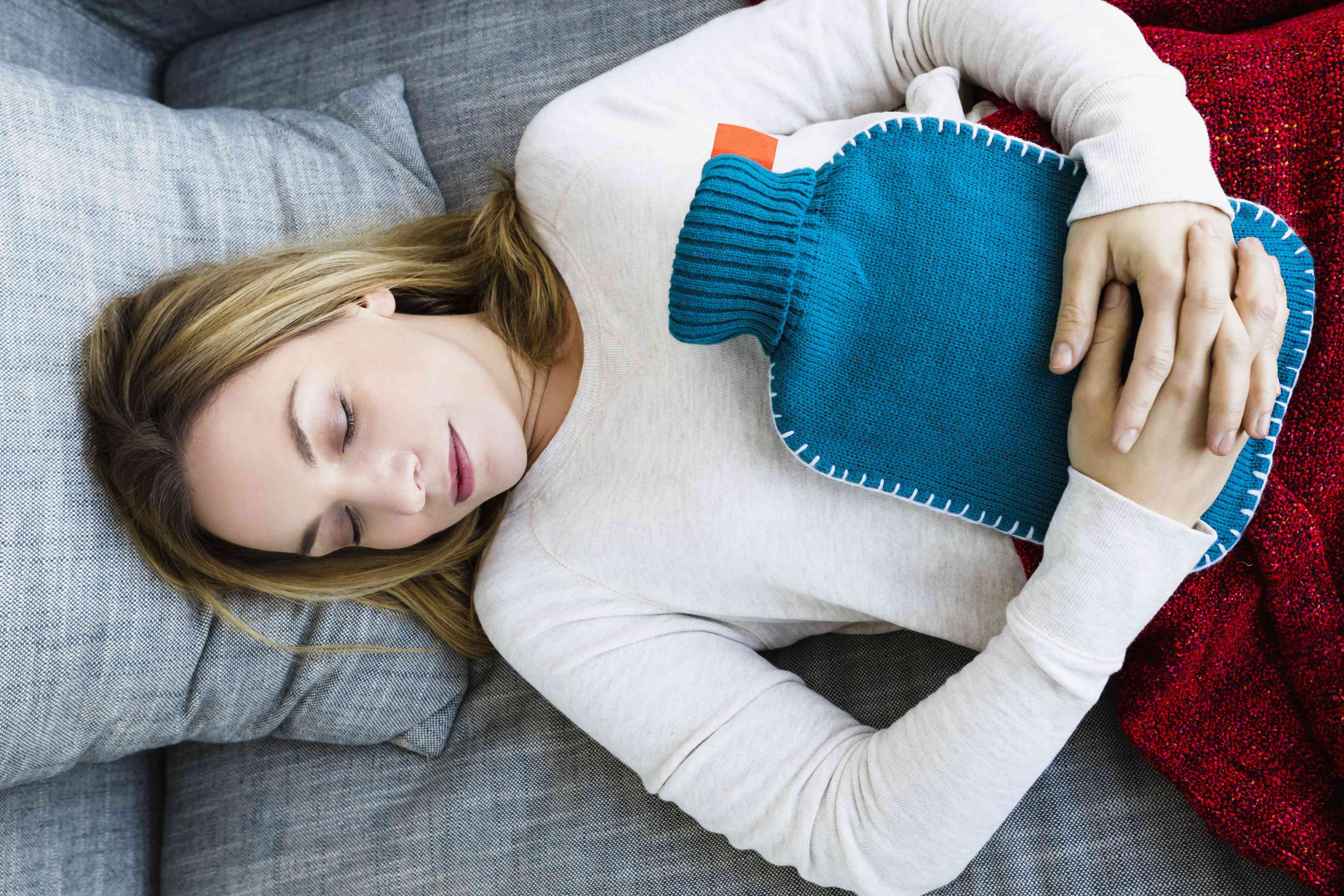 Woman with heating pad