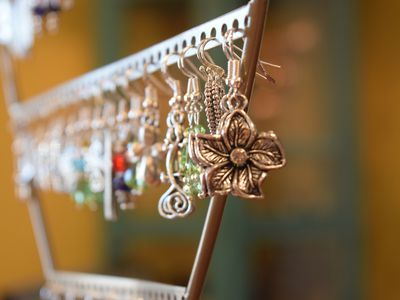 Earrings made of nickel hanging on a stand