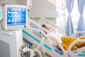 Ventilator monitor ,given oxygen by intubation tube to patient, setting in ICU/Emergency room