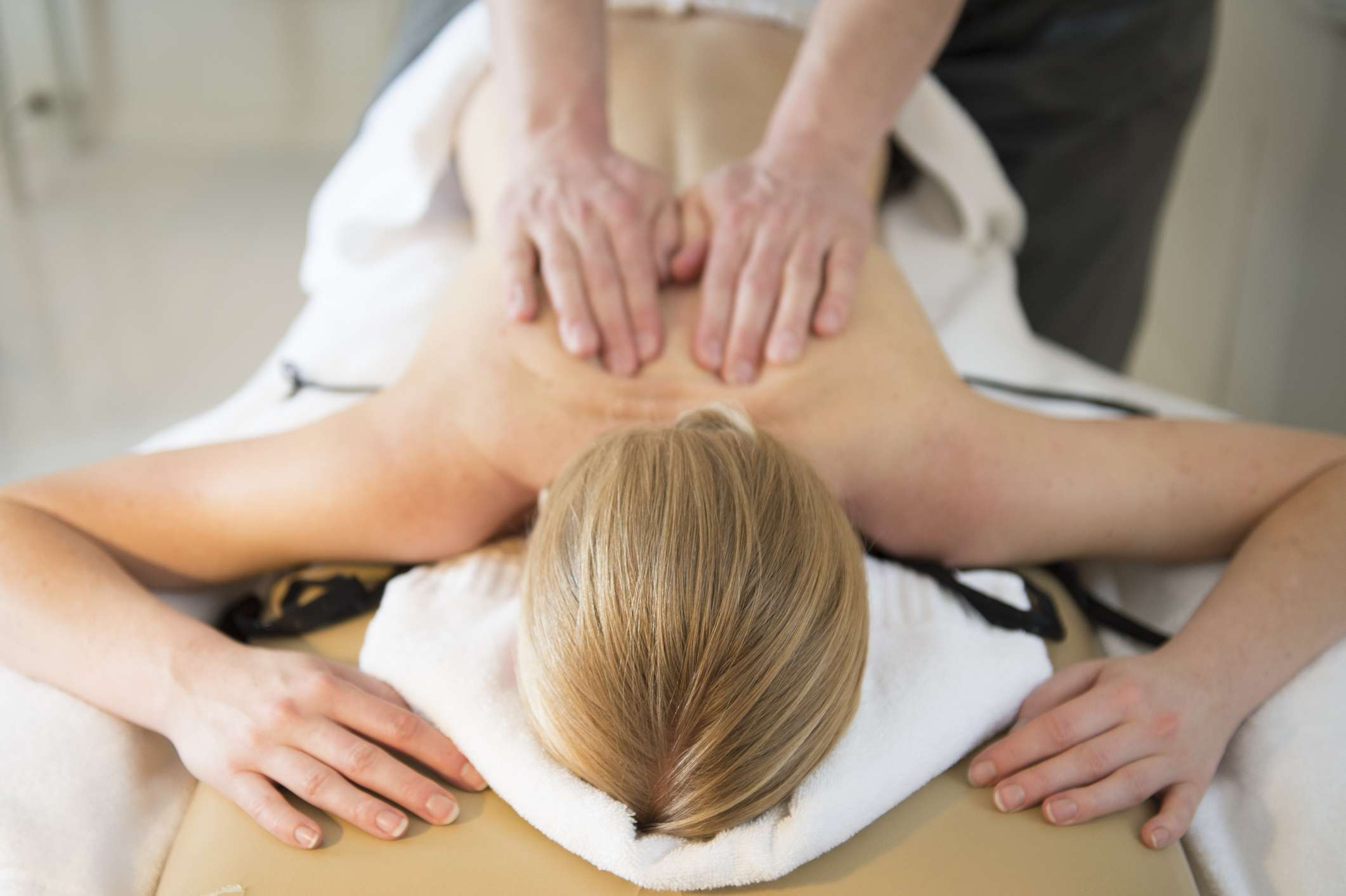 Woman getting back and neck massage
