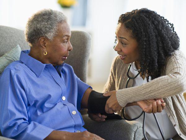 Older person has blood pressure taken
