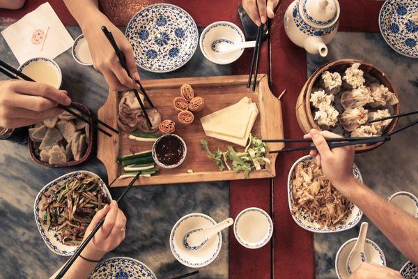 overheat shot of people enjoying Chinese food