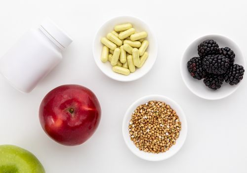 Quercetin capsules, blackberries, apples, and buckwheat