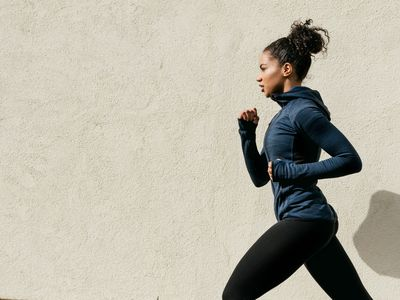 Woman Running With a Wall in the Background