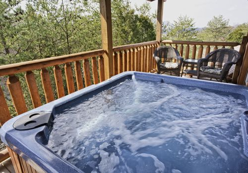 Empty hot tub on a deck