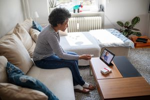 Senior woman on a video telemedicine call with a doctor at home