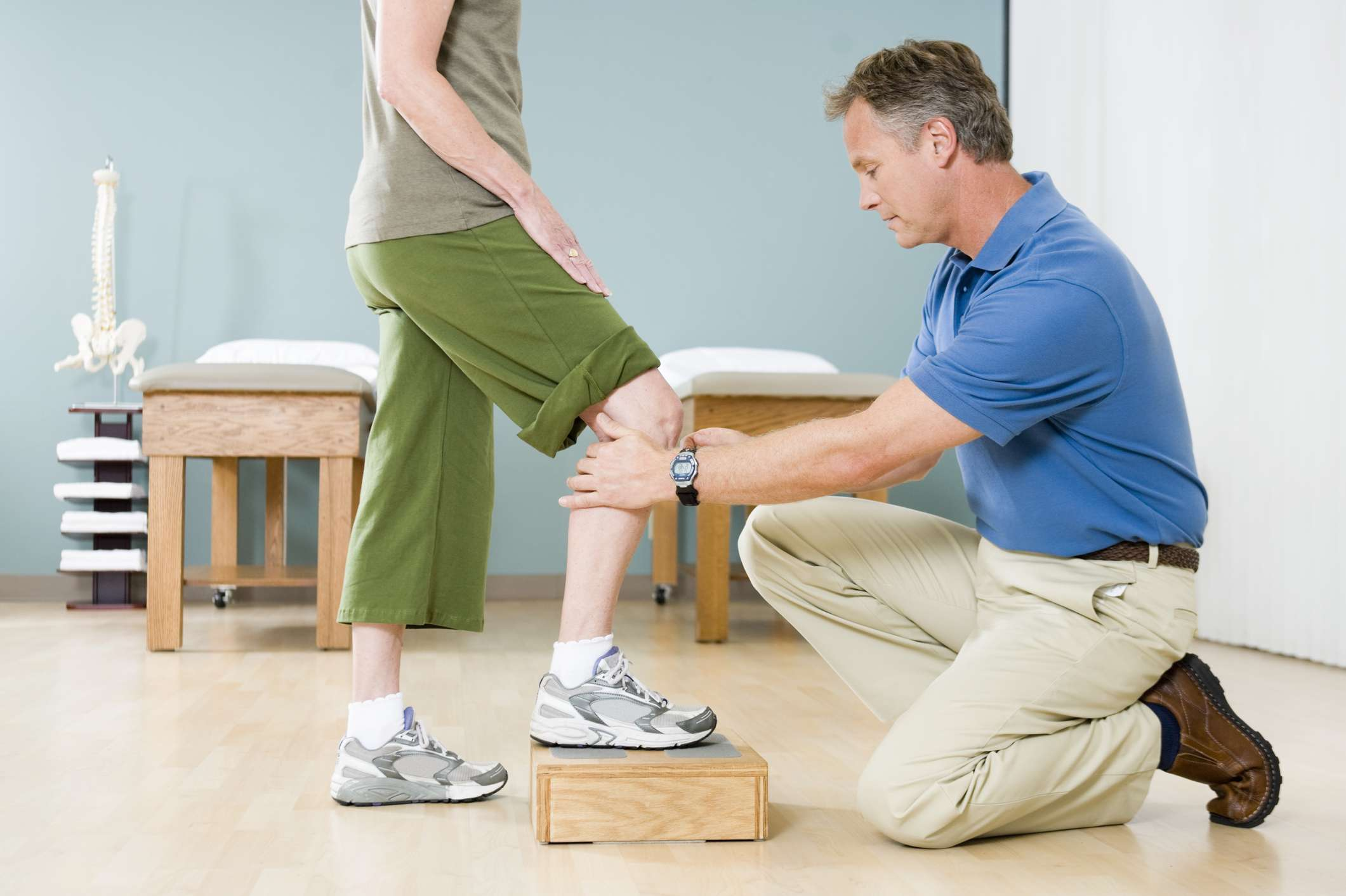 two people doing physical therapy