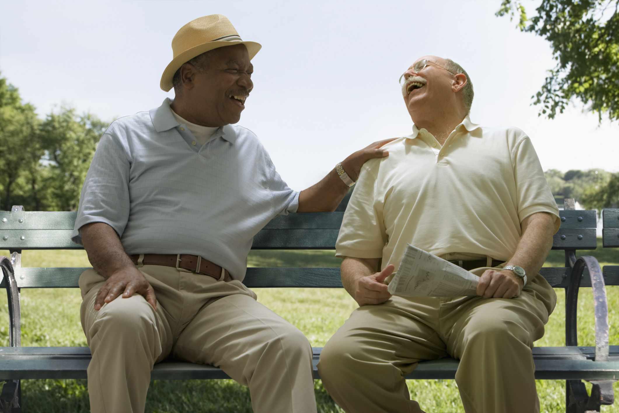 Men laughing on bench
