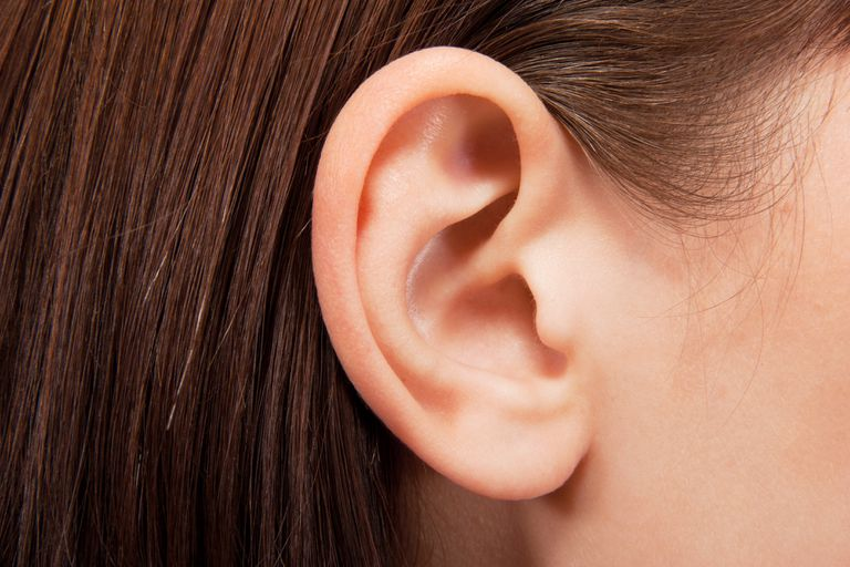 Closeup of a woman's ear. The ear is often affected with relapsing polychondritis.
