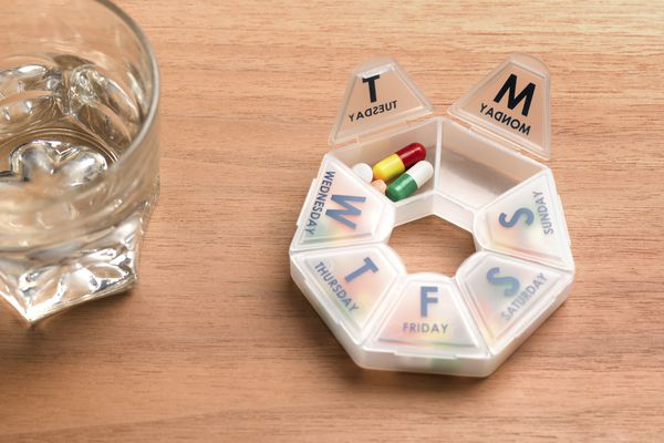 Weekly pill organiser and dispenser daily routine