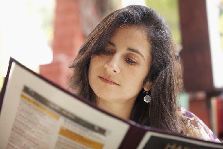 woman looking at a menu