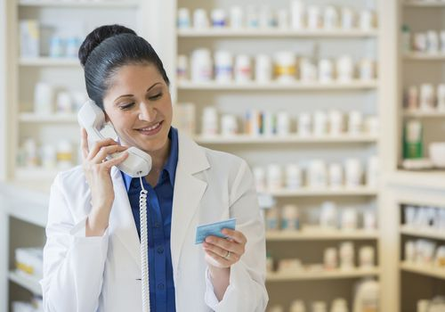 Pharmacist talking on telephone