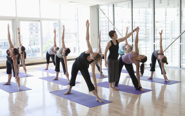 Yoga Teacher Leading a Class