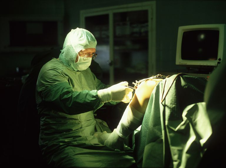 doctor performing arthroscopic surgery on a knee