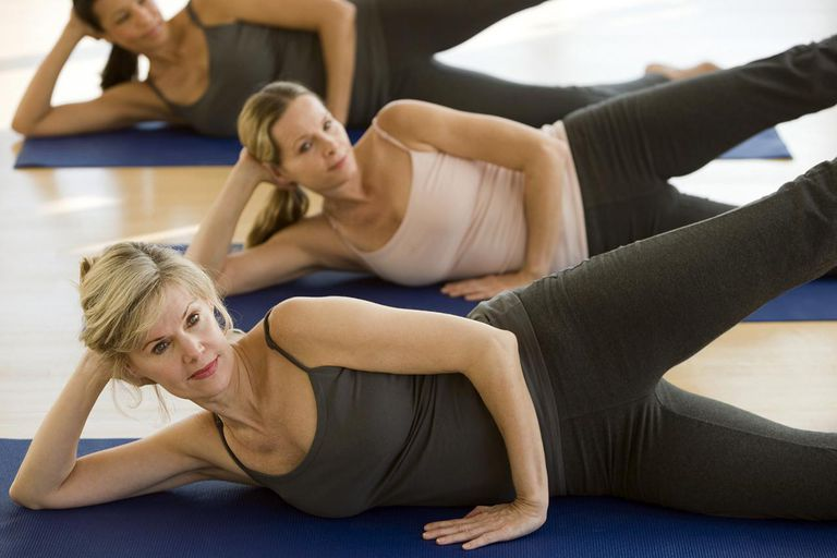 Multi-ethnic women practicing yoga.